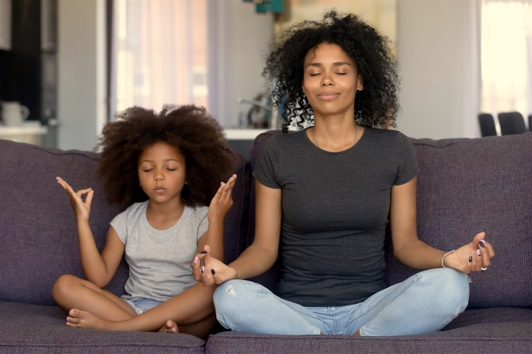 Mindful African Mom With Funny Kid Daughter Doing Yoga Together